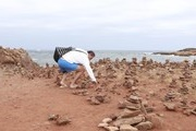 Pyramid of stones made by tourists, ruining the Balearic Islands